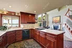 mahogany kitchen cabinets marble counter tops backsplash and