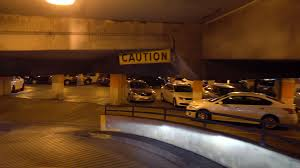 a perspective of driving down a curvy parking garage exit ramp a perspective of driving down a curvy parking garage exit ramp stock video footage videoblocks