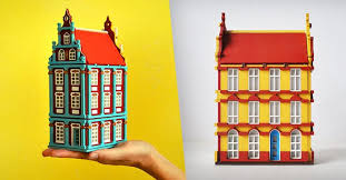 artist handcrafts brightly colored miniature houses