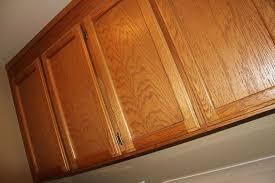 To Paint Or Stain Kitchen by How To Paint Oak Cabinets Without Sanding Or Priming Lollypaper