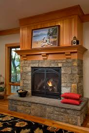rustic stone fireplace at lake house teakwood builders