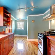 cherry cabinets in kitchen with what color paint blue kitchen with cherry cabinets and shiny floor