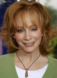 medium hairstyles flipped up reba mcentire s practical and bouncy red hair with flipped out ends
