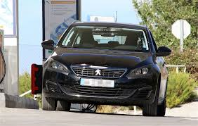 peugeot little car peugeot 308 facelift spied with little camouflage expect it in