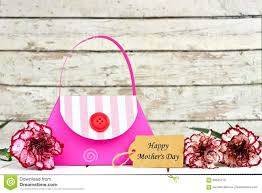 purse gift bags mothers day purse gift bag with tag and flowers stock photo