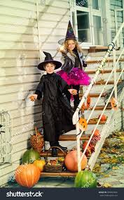 happy children costumes witches wizards celebrating stock photo