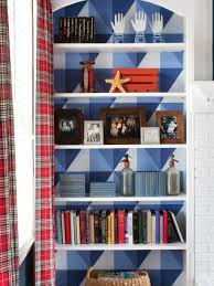 add graphic pop to a bookcase with wallpaper hgtv