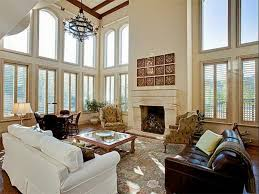 High Fireplace Area Rugs High Ceiling Beige Persian Rug Brown Bonded Leather