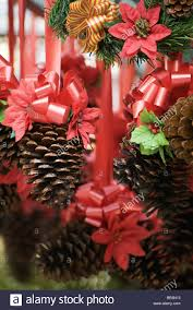 pine cone and poinsettia christmas decorations stock photo