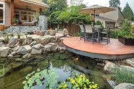 Pond In Backyard by Pond With Bridge Water Wizard Garden Ponds Water Features