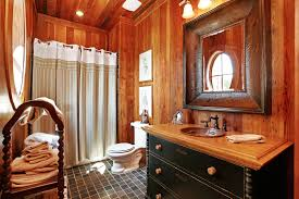bathroom beautiful country decorating big white bathtub elegant classic bathroom design wooden cabinet small lamps water sink cream colored towels