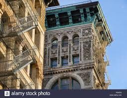 building facade with terra cotta ornament copper cornice and
