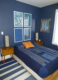 young mans bedroom in benjamin moore hale navy walls with japanese