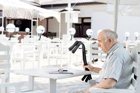 under the table jobs for disabled disabled man sitting at an outdoor restaurant stock photo image of