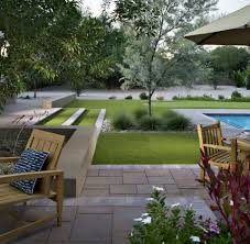create a park like landscape using artificial grass pavers