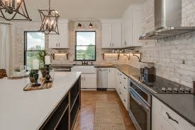 kitchen brick accent wall painted cabinets granite counters