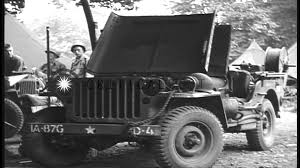 ww2 jeep front us soldiers in england install wire cutters on us jeeps before