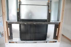 modern glass fireplace doors brandner design hilltop modern guillotine fireplace door