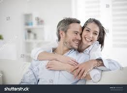 couple home relaxing sofa stock photo 169601618 shutterstock