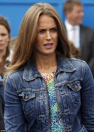 kim sears dresses down a pretty print dress with denim jacket as