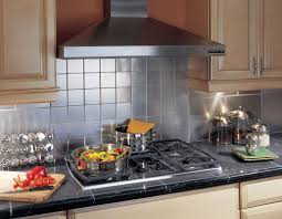 kitchen stainless steel backsplash tile behind stove with range