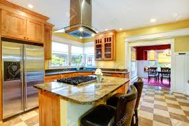 yellow kitchen interior view of island with built in stove and