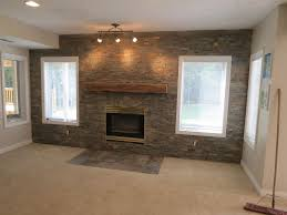 textured accent wall grey exposed brick stone accent wall combine with wooden fireplace