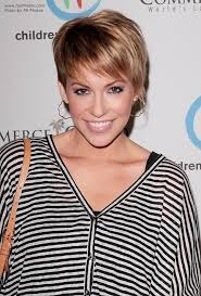 short haircut with ear showing farah fath short above the ears hairstyle with wispy bangs