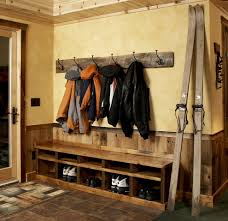wall mount coat rack in entry rustic with wood door frame next to