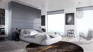 bedroom low profile bed with gray duvet and modern accent pillows
