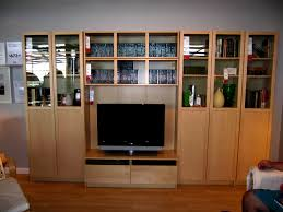 wooden entertainment center ikea with glass bookcase doors and