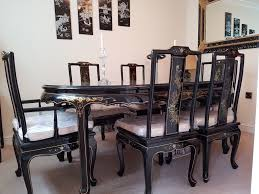 oriental black lacquered dining table with 6 chairs in