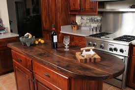 custom wood countertop options finishes tung oil citrus finish shown on a face grain walnut island top