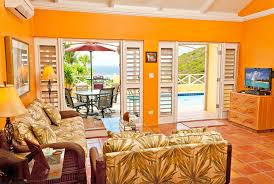 tropical colors for home interior tropical living room with crown molding exposed beam zillow