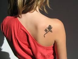 black feminine rose tattoo on right back shoulder