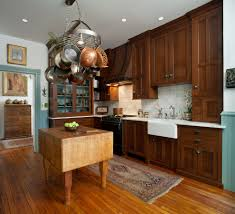 oak cabinets kitchen traditional with ceiling mounted pot rack oak cabinets kitchen traditional with ceiling mounted pot rack blue wainscoting