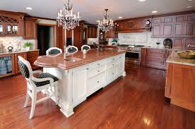 399 kitchen island ideas for 2017 white island with rosy marble countertop under dual chandeliers stands apart in this natural wood toned