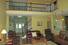 traditional living room with balcony hardwood floors in
