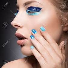 beautiful with bright creative fashion makeup and blue nail