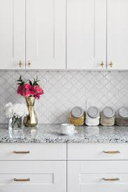 kitchen tile backsplash behind sink stainless steel faucet with kitchen stunning white kitchen backsplash tiles ideas with white kitchen cabinet marble countertop for small