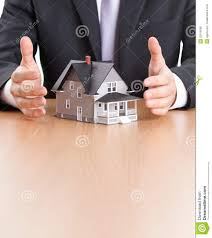 businessman hands around house architectural model royalty free