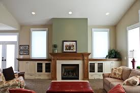 Fireplace In Family Room With Built Ins Under Windows - Family room built ins