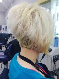 layered buzzed bob hair a layered a line bob with a small stack in the back the