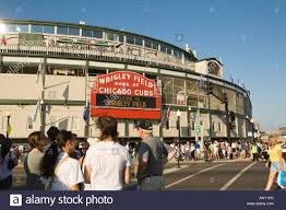 wrigley field stadium sign stock photos wrigley field stadium illinois chicago pedestrians in crosswalk outside wrigley field on game day stadium for chicago cubs baseball