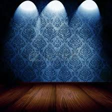 vintage room with spotlights on blue damask wallpaper stock photo