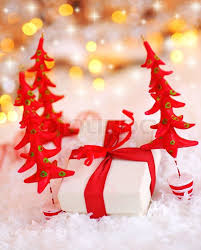 christmas tree with white lights and red bows holiday background with white present gift box wrapped with red