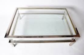 vintage sliding glass top coffee table attributed to maison jansen