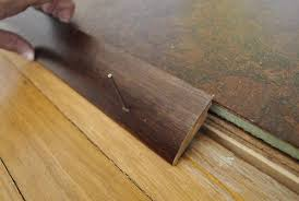 Laminate Floor Trim How To Add Floor Trim Transitions And Reducers Floor Trim