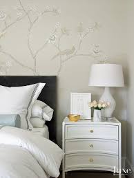 transitional neutral bedroom detail with curved nightstand luxe