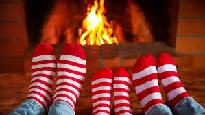 new years socks girl in christmas socks near fireplace woman relaxing at home